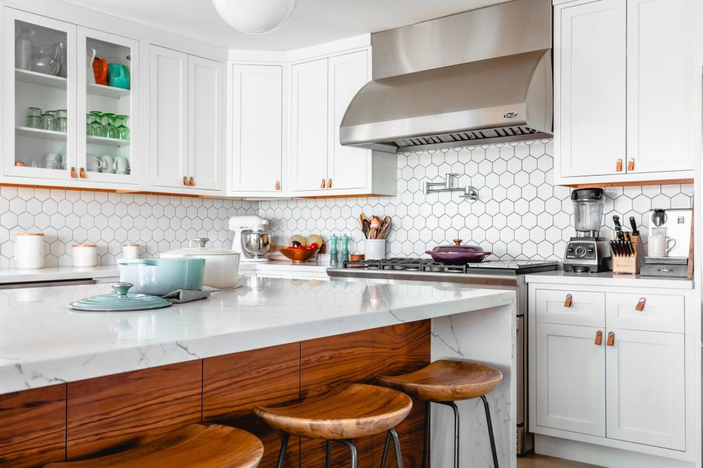 White kitchen with brown accents, hood stove, and white tile backsplash